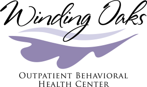Logo for Winding Oaks Outpatient Behavioral Health center in cursive with leaves below