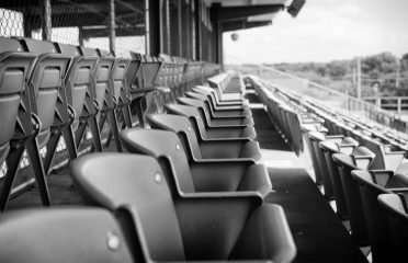 empty baseball seats in black and white